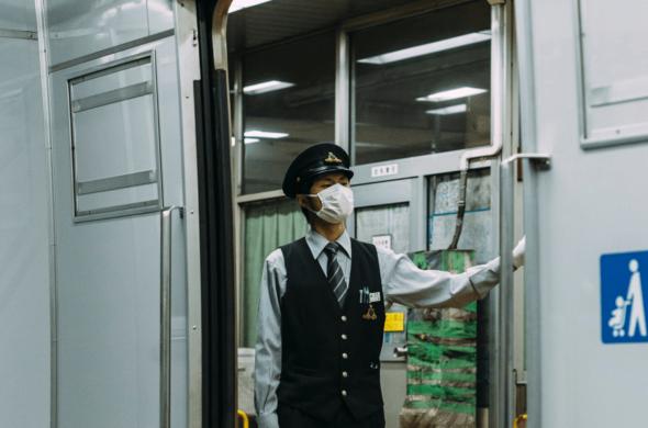 subway conductor wearing a mask