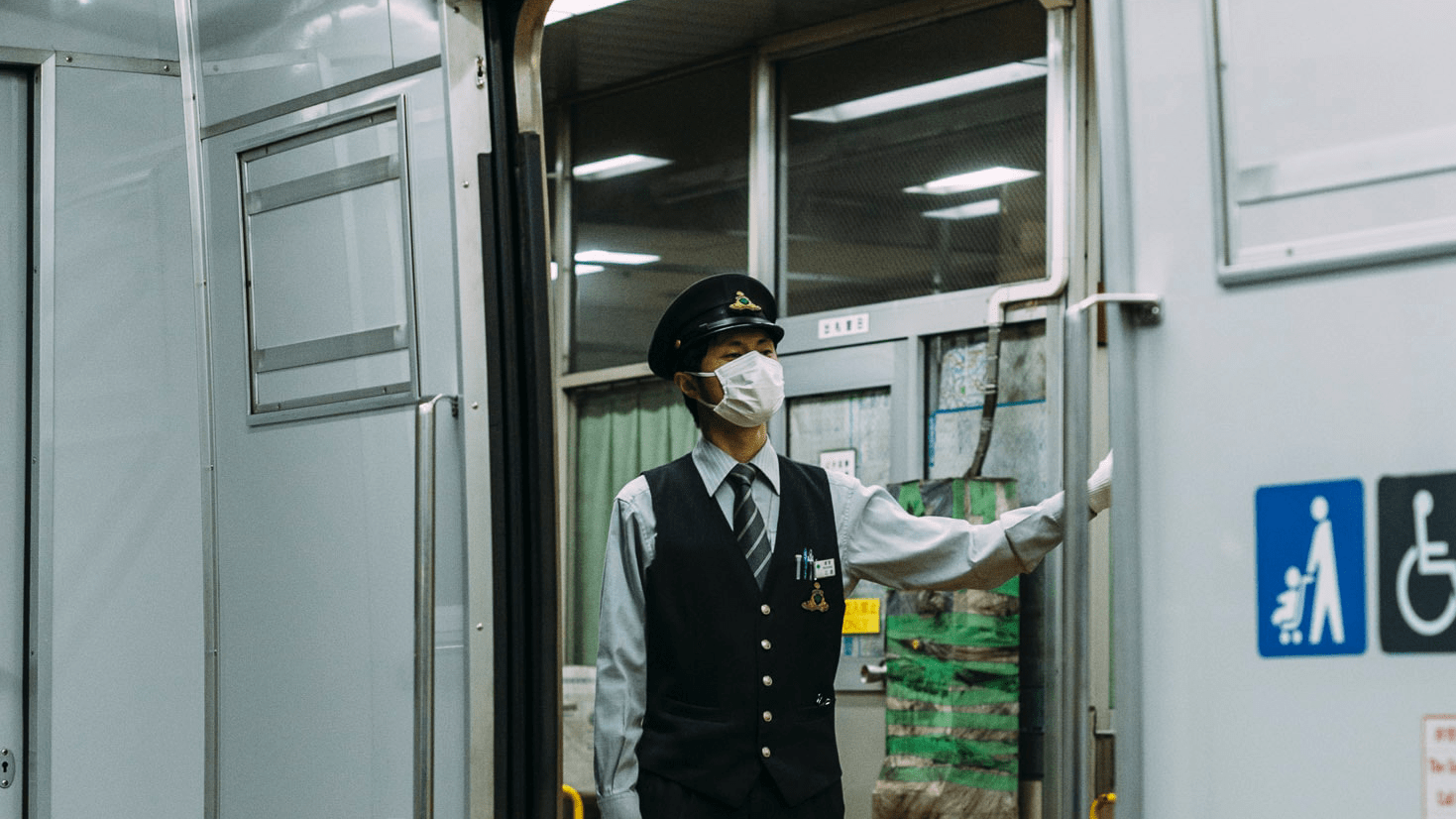 subway conductor wearing a mask