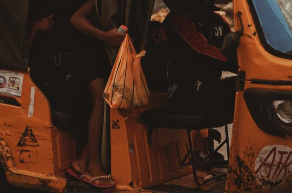 passengers getting on moto-taxi in Lagos, Nigeria